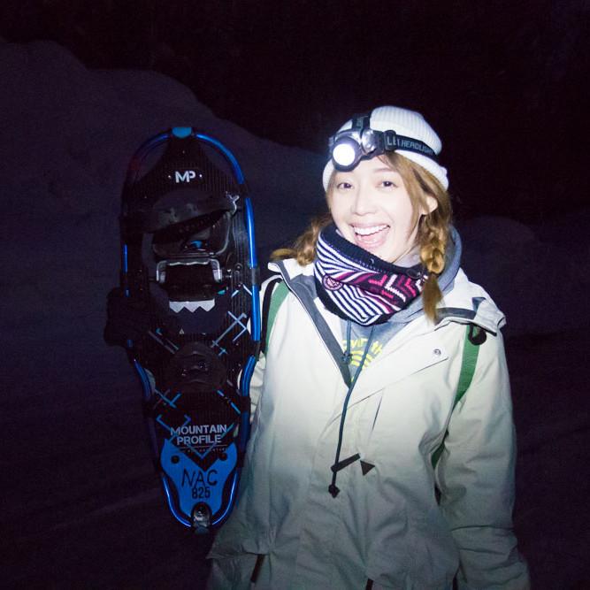 Holding snowshoe at night